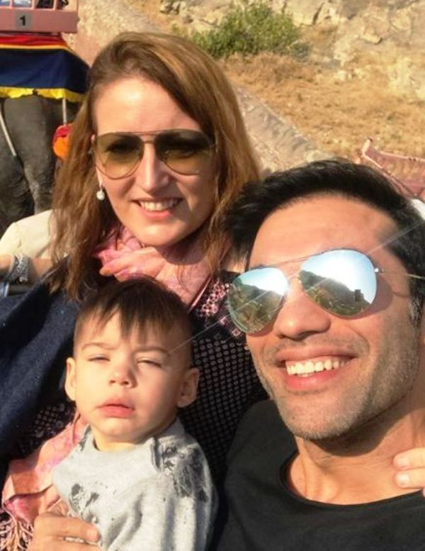 This image has an empty alt attribute; its file name is Audrey-Dolhen-with-Kushal-Punjabi-and-their-Son.jpg